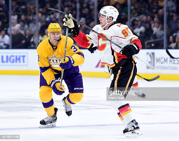 Brayden McNabb of the Los Angeles Kings and Sam Bennett of the Calgary Flames play a puck in the air during the first period at Staples Center on...