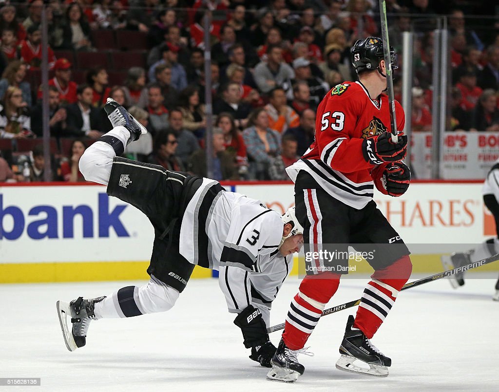 Brayden McNabb #3 of the Los Angeles Kings goes airborne after colliding with Brandon Mashinter #53 of the Chicago Blackhawks at the United Center on March 14, 2016 in Chicago, Illinois.