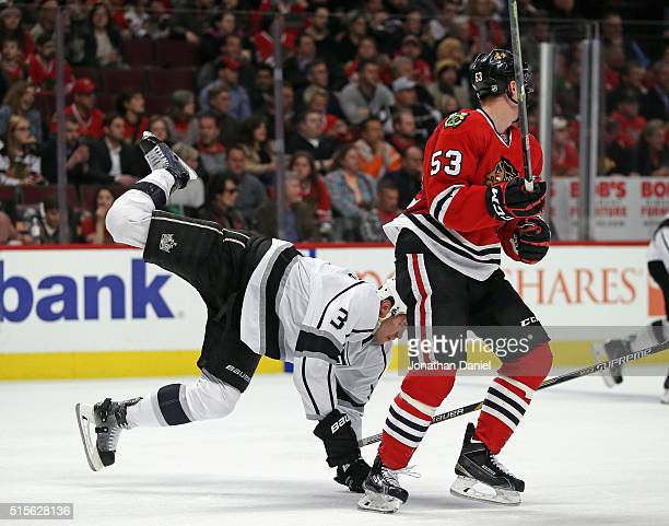 Brayden McNabb of the Los Angeles Kings goes airborne after colliding with Brandon Mashinter of the Chicago Blackhawks at the United Center on March...