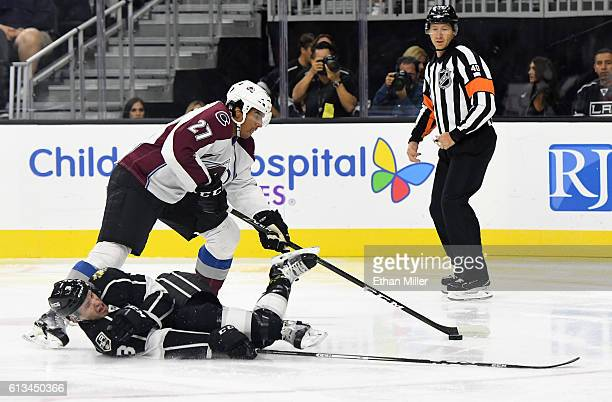 Brayden McNabb of the Los Angeles Kings tries to block a shot by Andreas Martinsen of the Colorado Avalanche during their preseason game at T-Mobile...