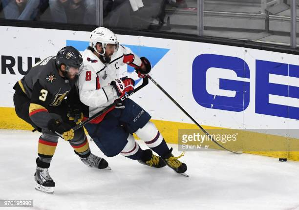 Brayden McNabb of the Vegas Golden Knights and Alex Ovechkin of the Washington Capitals battle for the puck in the first period of Game Five of the...