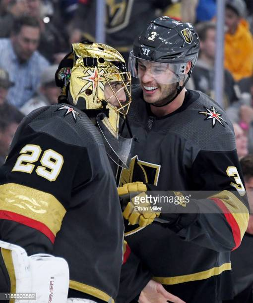 Brayden McNabb of the Vegas Golden Knights congratulates teammate MarcAndre Fleury during a stop in play after Fleury made a save against the Toronto...