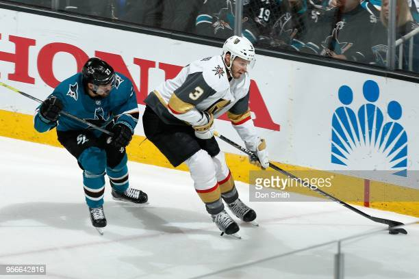 Brayden McNabb of the Vegas Golden Knights controls the puck ahead of Joonas Donskoi of the San Jose Sharks in Game Six of the Western Conference...
