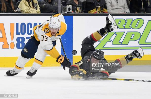 Brayden McNabb of the Vegas Golden Knights knocks the puck away from Viktor Arvidsson of the Nashville Predators in the third period of their game at...