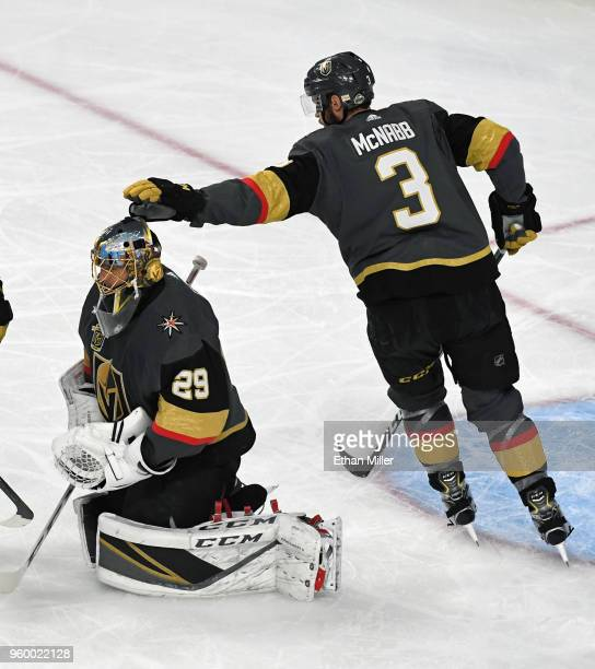 Brayden McNabb of the Vegas Golden Knights pats teammate MarcAndre Fleury on the head after he made a save on a shot by Patrik Laine of the Winnipeg...