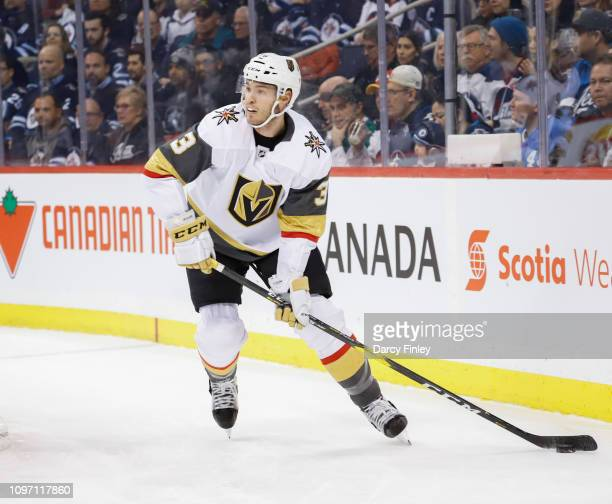 Brayden McNabb of the Vegas Golden Knights plays the puck along the boards during first period action against the Winnipeg Jets at the Bell MTS Place...