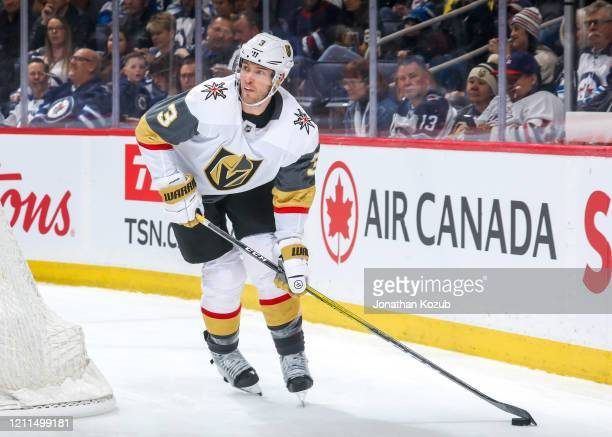 Brayden McNabb of the Vegas Golden Knights plays the puck behind the net during third period action against the Winnipeg Jets at the Bell MTS Place...