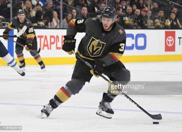 Brayden McNabb of the Vegas Golden Knights skates with the puck against the Winnipeg Jets in the second period of their game at T-Mobile Arena on...