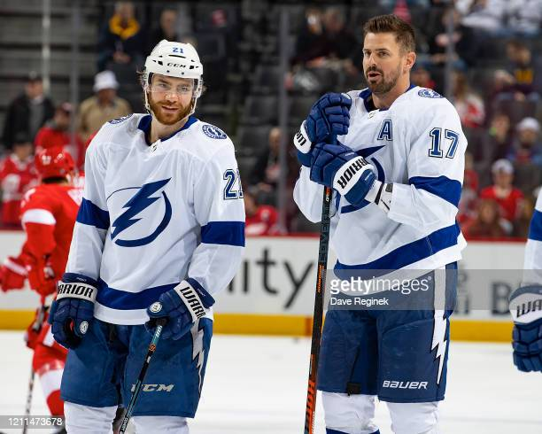 Brayden Point and Alex Killorn of the Tampa Bay Lightning chat in warm ups prior to an NHL game against the Detroit Red Wings at Little Caesars Arena...