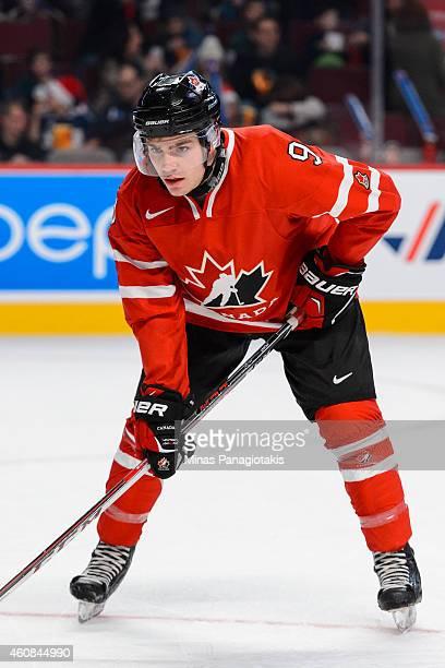 Brayden Point of Team Canada looks on prior to a faceoff during the 2015 IIHF World Junior Hockey Championship exhibition against Team Switzerland...