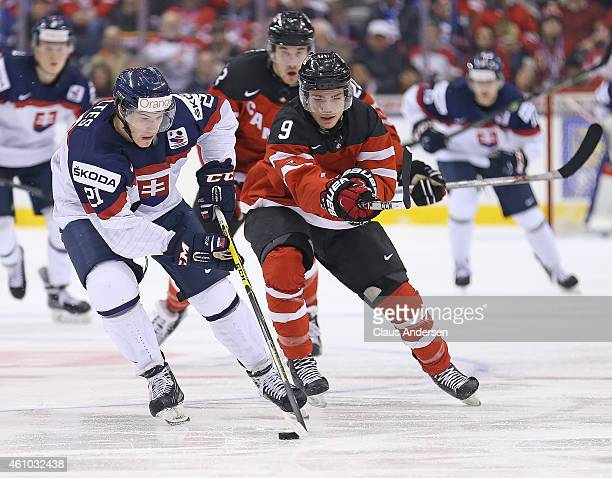 Brayden Point of Team Canada makes a stick check at David Soltes of Team Slovakia during a semifinal game in the 2015 IIHF World Junior Hockey...