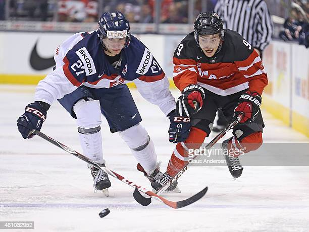 Brayden Point of Team Canada skates against Michael Kabac of Team Slovakia during a semifinal game in the 2015 IIHF World Junior Hockey Championship...