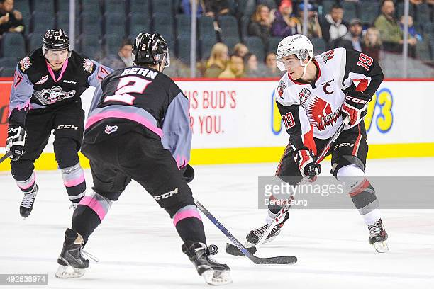 Brayden Point of the Moose Jaw Warriors skates with the puck against Jake Bean of the Calgary Hitmen during a WHL game at Scotiabank Saddledome on...