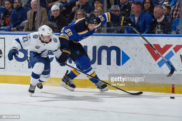 Brayden Point of the Tampa Bay Lightning and Colton Parayko of the St Louis Blues battle for control of the puck at Scottrade Center on December 12...