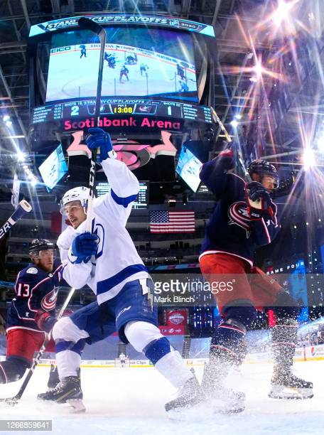 Brayden Point of the Tampa Bay Lightning and Seth Jones of the Columbus Blue Jackets stop together in front of the net during the third period of...