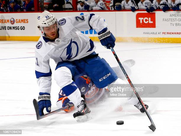 Brayden Point of the Tampa Bay Lightning battles for the puck with Matt Martin of the New York Islanders during the third period at Barclays Center...