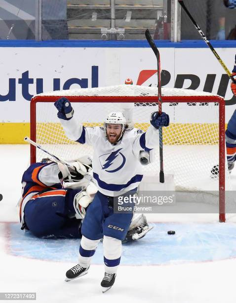 Brayden Point of the Tampa Bay Lightning celebrates after scoring a goal past Semyon Varlamov of the New York Islanders during the third period in...