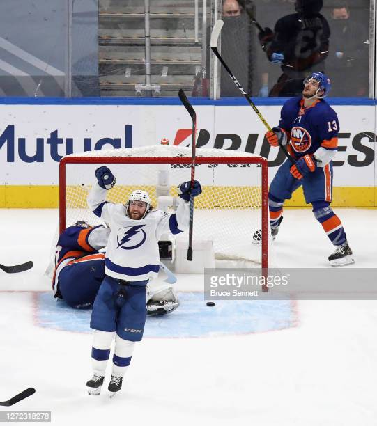 Brayden Point of the Tampa Bay Lightning celebrates after scoring a goal past Semyon Varlamov of the New York Islanders as Mathew Barzal reacts...