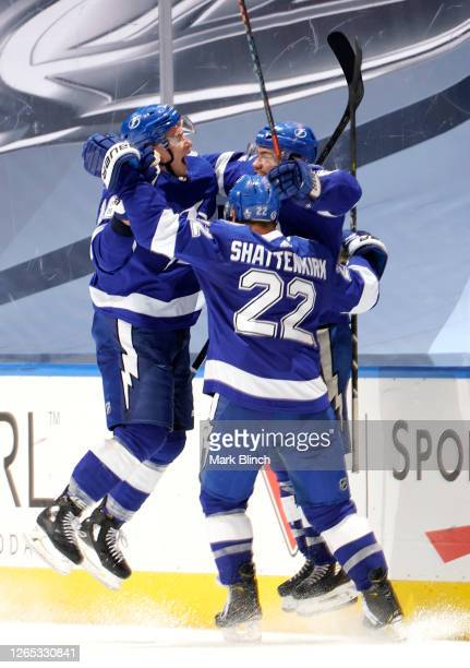 Brayden Point of the Tampa Bay Lightning celebrates his game winning goal at 10:27 in the fifth overtime with teammates Ondrej Palat and Kevin...