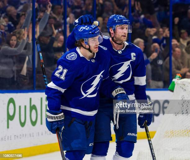 Brayden Point of the Tampa Bay Lightning celebrates his goal with teammate Steven Stamkos against the Carolina Hurricanes during the third period at...