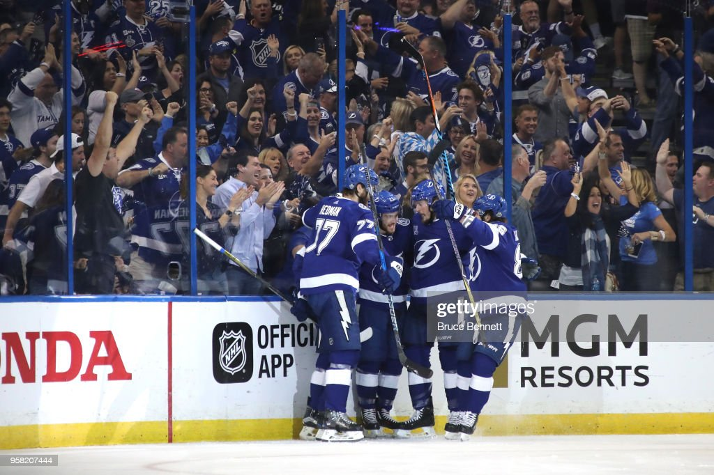 Brayden Point #21 of the Tampa Bay Lightning celebrates with his teammates after scoring a goal on Braden Holtby #70 of the Washington Capitals during the first period in Game Two of the Eastern Conference Finals during the 2018 NHL Stanley Cup Playoffs at Amalie Arena on May 13, 2018 in Tampa, Florida.