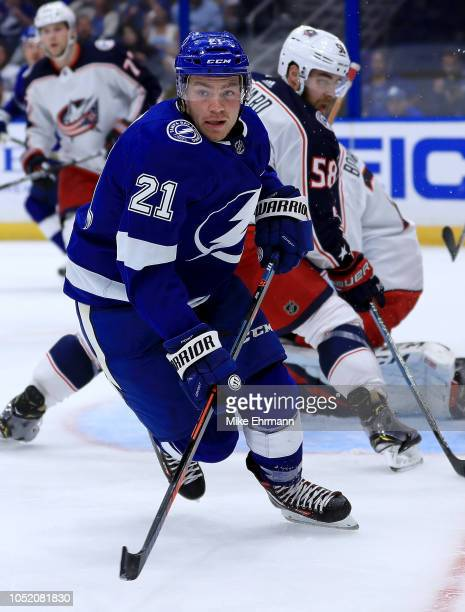 Brayden Point of the Tampa Bay Lightning celooks to pass during a game against the Columbus Blue Jackets at Amalie Arena on October 16 2018 in Tampa...