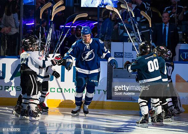 Brayden Point of the Tampa Bay Lightning greets fans during the play introductions before the game against the Detroit Red Wings at Amalie Arena on...