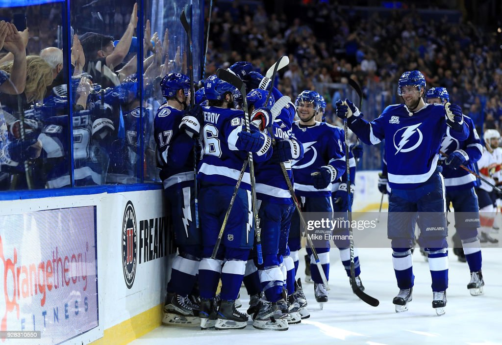 Brayden Point #21 of the Tampa Bay Lightning is congratulated after scoring the game winning goal in overtime during a game against the Florida Panthers at Amalie Arena on March 6, 2018 in Tampa, Florida.