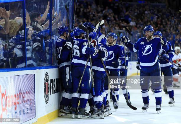 Brayden Point of the Tampa Bay Lightning is congratulated after scoring the game winning goal in overtime during a game against the Florida Panthers...