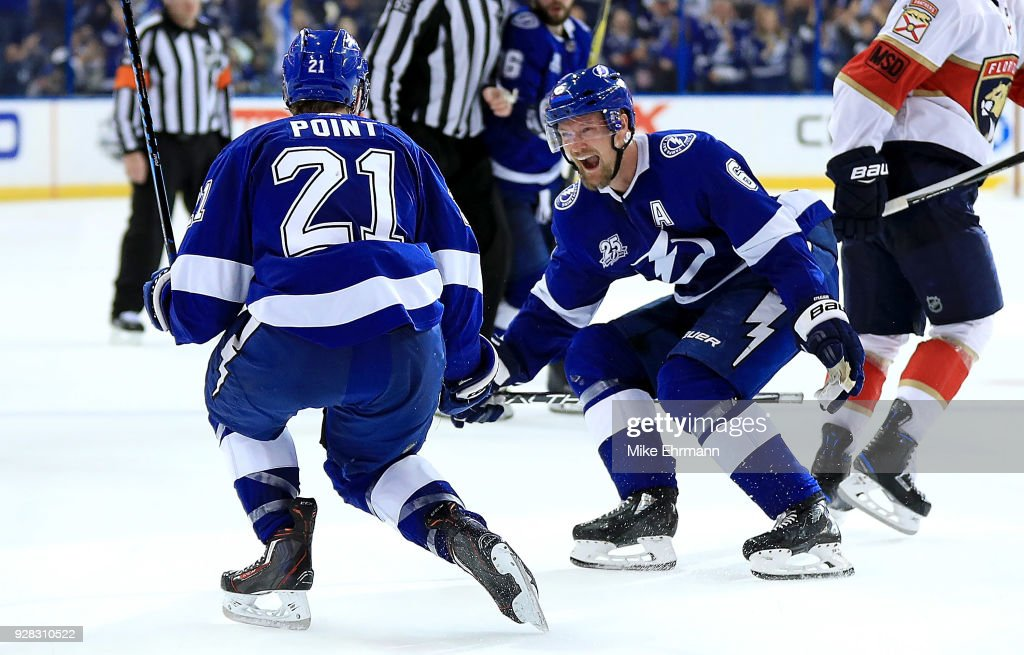 Brayden Point #21 of the Tampa Bay Lightning is congratulated by Anton Stralman #6 after scoring the game winning goal in overtime during a game against the Florida Panthers at Amalie Arena on March 6, 2018 in Tampa, Florida.