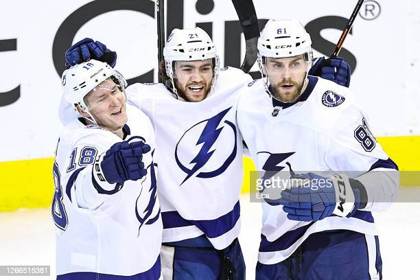 Brayden Point of the Tampa Bay Lightning is congratulated by his teammates Ondrej Palat and Erik Cernak after scoring a goal against the Columbus...