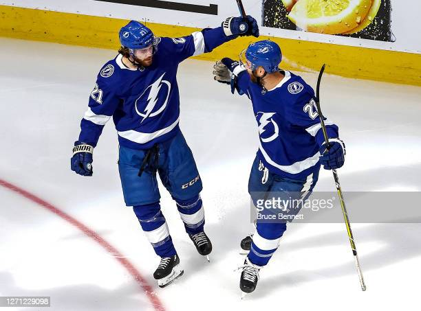 Brayden Point of the Tampa Bay Lightning is congratulated by Kevin Shattenkirk after scoring a goal against the New York Islanders in Game One of the...