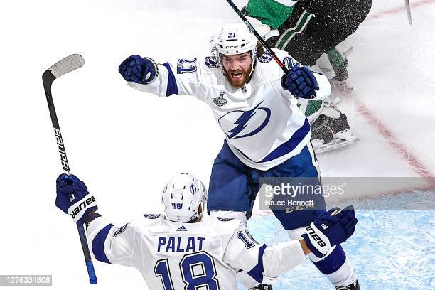 Brayden Point of the Tampa Bay Lightning is congratulated by Ondrej Palat after scoring a goal against the Dallas Stars during the second period in...