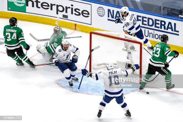 Brayden Point of the Tampa Bay Lightning is congratulated by Ondrej Palat after scoring a goal past Anton Khudobin of the Dallas Stars during the...