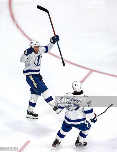 Brayden Point of the Tampa Bay Lightning is congratulated by Ryan McDonagh after scoring a goal against the New York Islanders during the third...