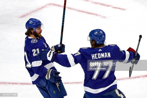 Brayden Point of the Tampa Bay Lightning is congratulated by Victor Hedman after scoring a goal against the Dallas Stars during the first period in...