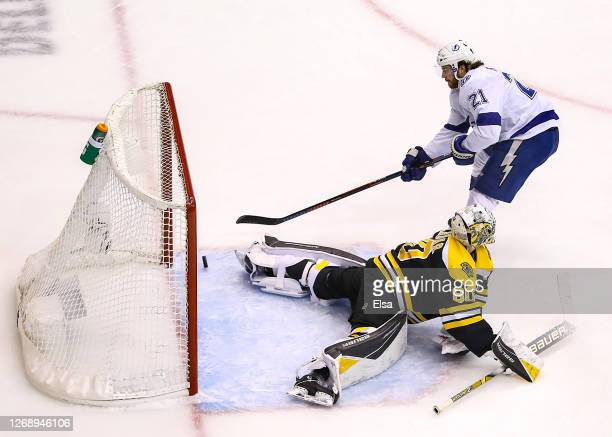 Brayden Point of the Tampa Bay Lightning scores a breakaway goal past Dan Vladar of the Boston Bruins during the second period in Game Three of the...