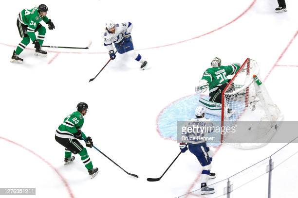 Brayden Point of the Tampa Bay Lightning scores a goal past Anton Khudobin of the Dallas Stars during the second period in Game Three of the 2020 NHL...