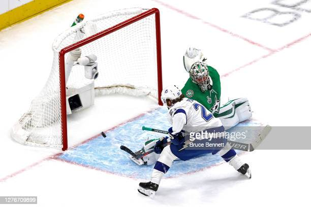 Brayden Point of the Tampa Bay Lightning scores a goal past Anton Khudobin of the Dallas Stars during the first period in Game Four of the 2020 NHL...