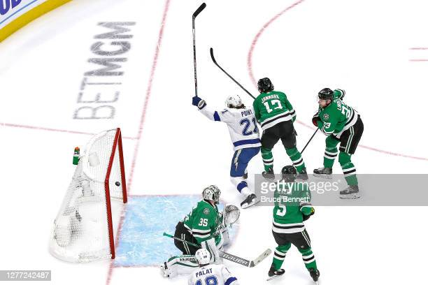 Brayden Point of the Tampa Bay Lightning scores a goal past Anton Khudobin of the Dallas Stars during the first period in Game Six of the 2020 NHL...