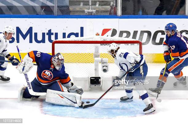 Brayden Point of the Tampa Bay Lightning scores a goal past Semyon Varlamov of the New York Islanders during the third period in Game Four of the...