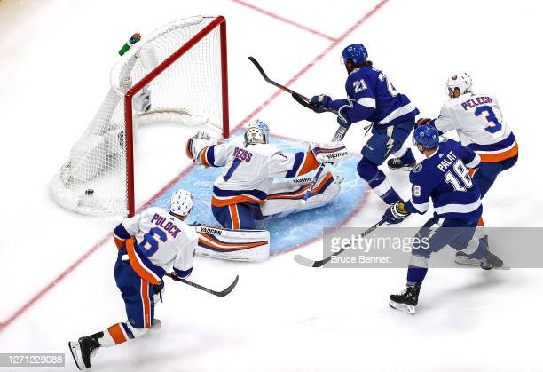 Brayden Point of the Tampa Bay Lightning scores a goal past Thomas Greiss of the New York Islanders during the first period in Game One of the...