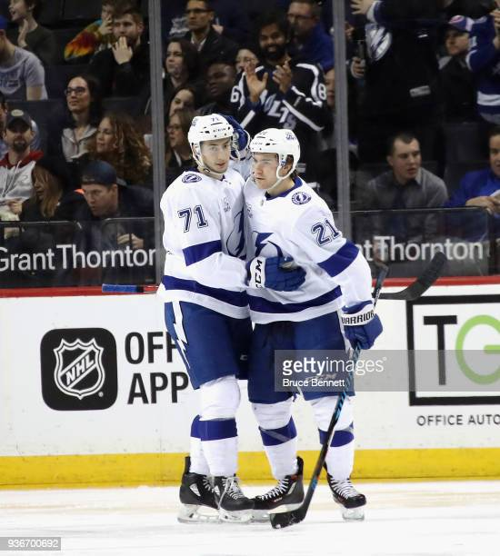 Brayden Point of the Tampa Bay Lightning scores a shorthanded second period goal and is greeted by Anthony Cirelli during the game against the New...