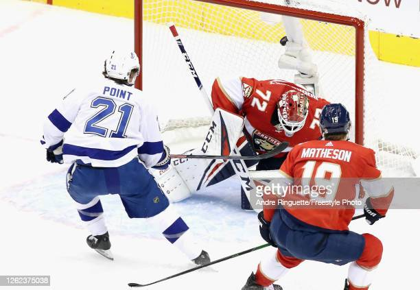 Brayden Point of the Tampa Bay Lightning scores his second goal of the first period against Sergei Bobrovsky of the Florida Panthers in an exhibition...