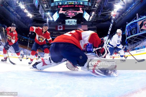 Brayden Point of the Tampa Bay Lightning scores on goaltender Sergei Bobrovsky of the Florida Panthers during the first period of the exhibition game...