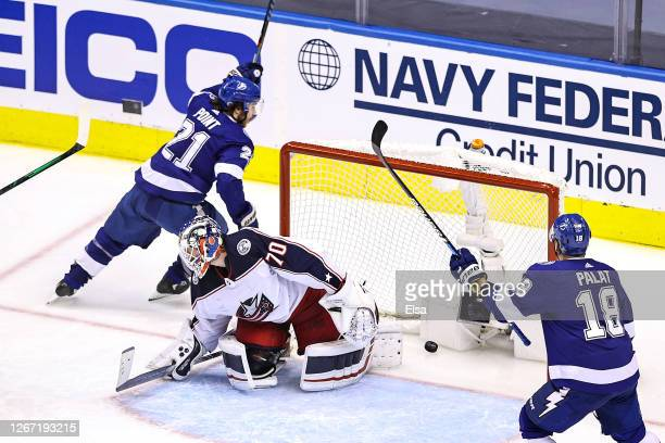 Brayden Point of the Tampa Bay Lightning scores the game winning goal past Joonas Korpisalo the Columbus Blue Jackets at 5:12 during the first...