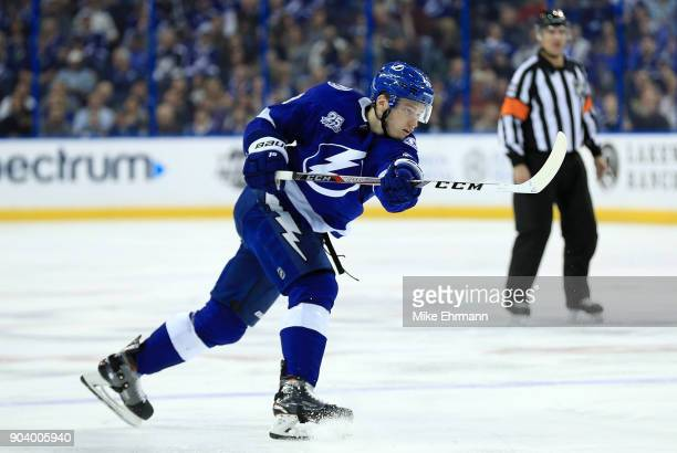 Brayden Point of the Tampa Bay Lightning shoots the puck during a game against the Calgary Flames at Amalie Arena on January 11 2018 in Tampa Florida