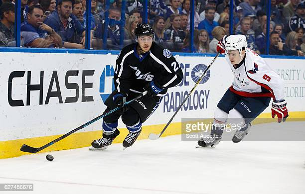 Brayden Point of the Tampa Bay Lightning skates against Dmitry Orlov of the Washington Capitals during the third period at Amalie Arena on December 3...
