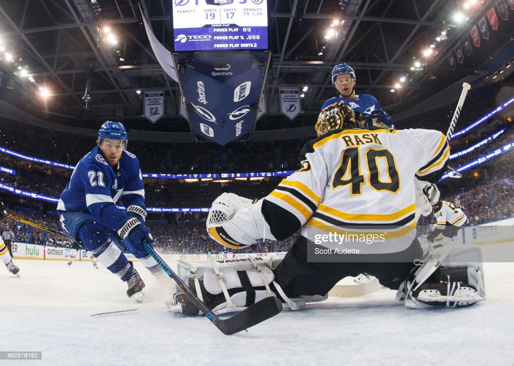 Brayden Point #21 of the Tampa Bay Lightning skates against goalie Tuukka Rask #40 of the Boston Bruins who loses a skate blade during Game One of the Eastern Conference Second Round during the 2018 NHL Stanley Cup Playoffs at Amalie Arena on April 28, 2018 in Tampa, Florida.