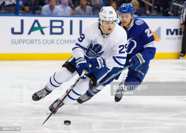 Brayden Point of the Tampa Bay Lightning skates against William Nylander of the Toronto Maple Leafs during the third period at Amalie Arena on March...